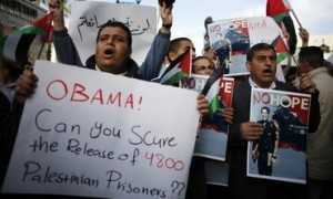 Palestinian protestors against Obama. Photo from REUTERS/Ammar Awad