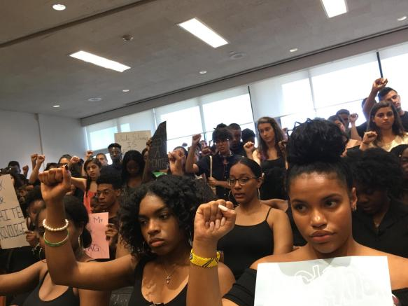 Black Students United silently protested at the University Assembly meeting on Tuesday. CREDIT: LAURA ROSBROW-TELEM